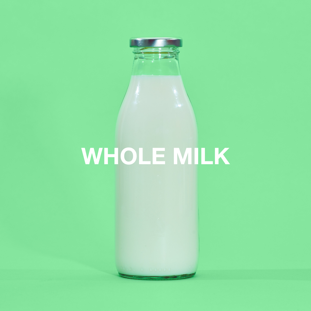 Milk in a glass bottle against green background