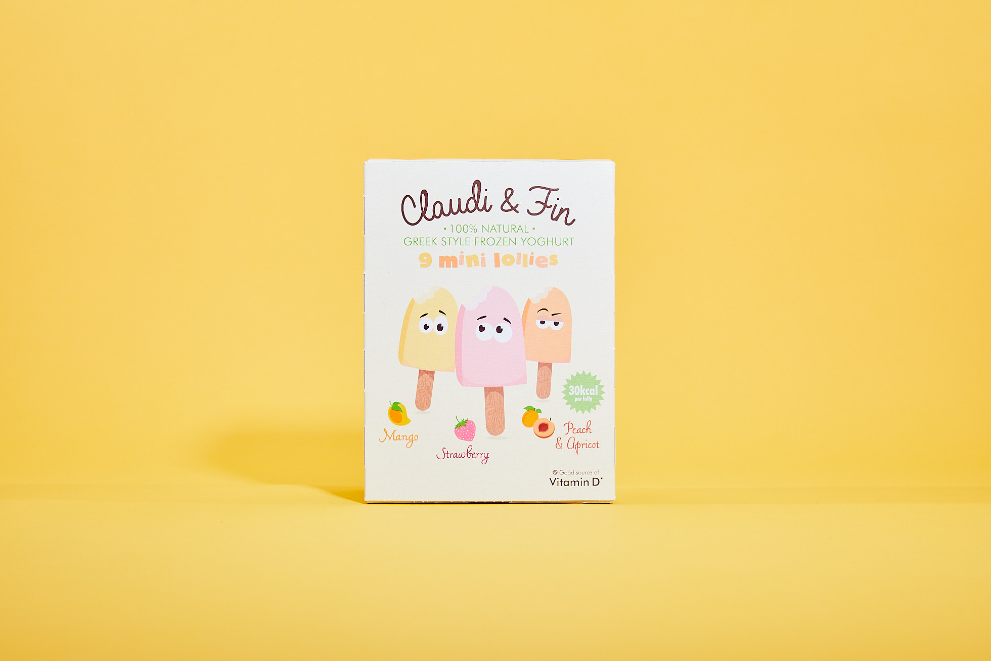 Box of Claudi and Fin ice lollies against a yellow background