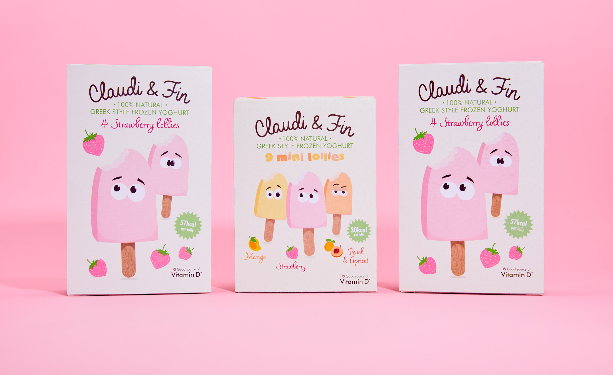 Three boxes of Claud and Fin lollies on pink background