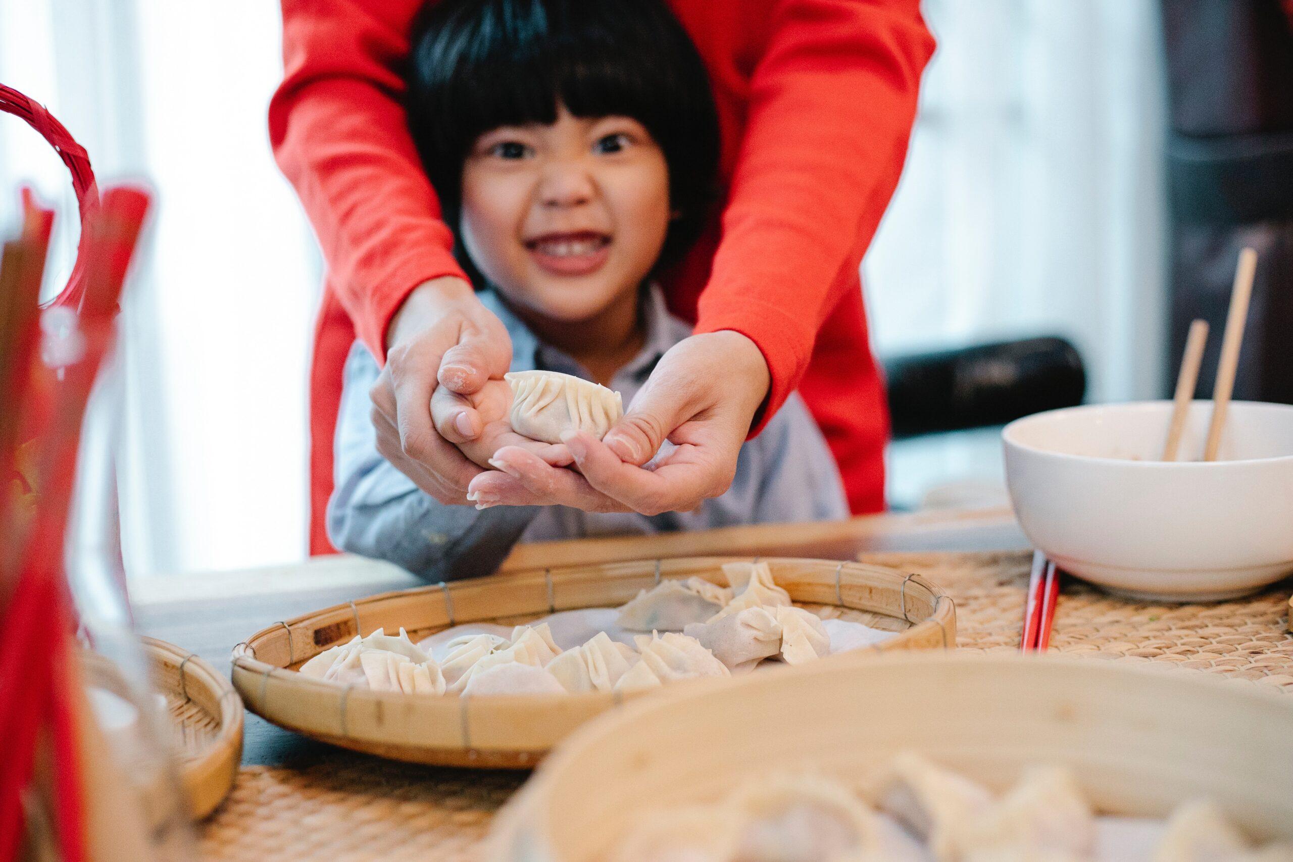 Little boy helping prepare food in the kitchen