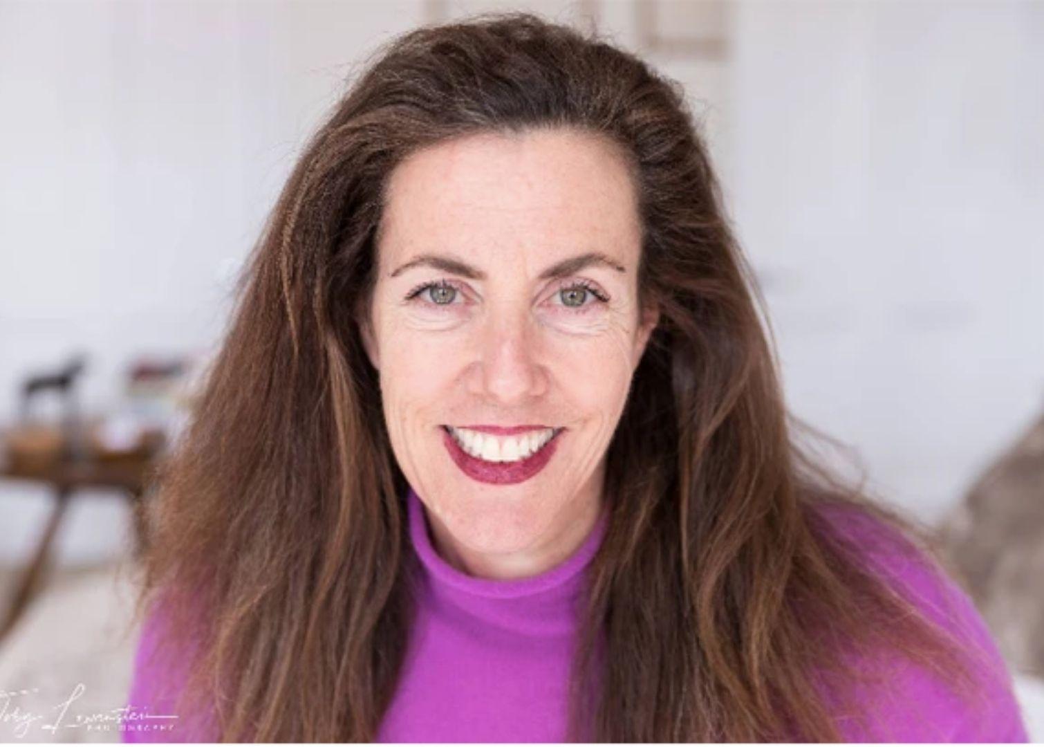 Photo of woman in purple jumper