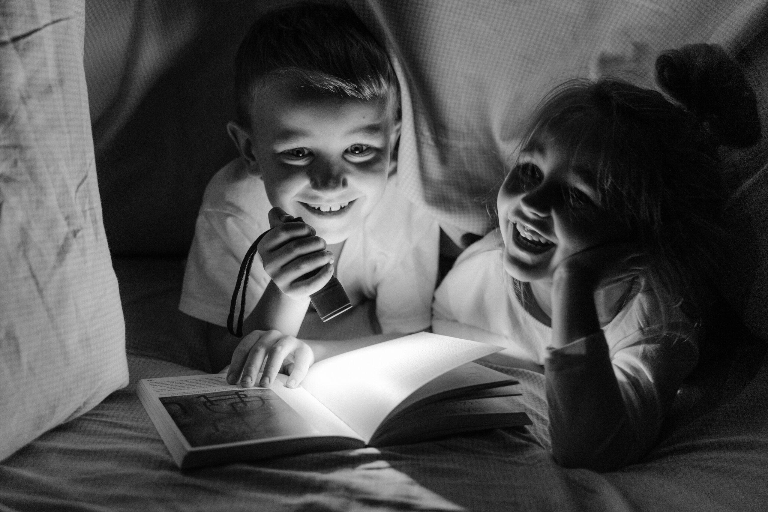 kids reading in a den